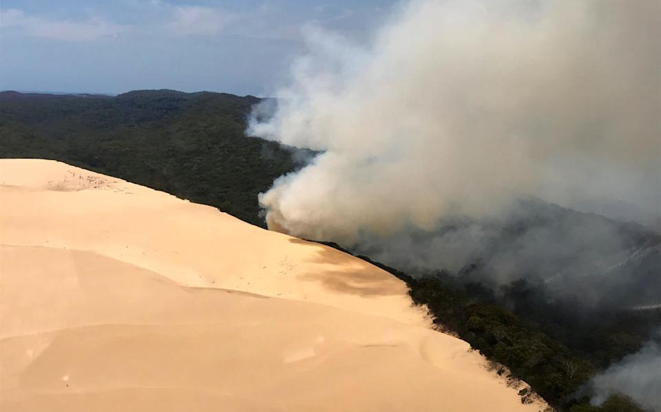 Plumes of smoke from a bushfire on Fraser Island.