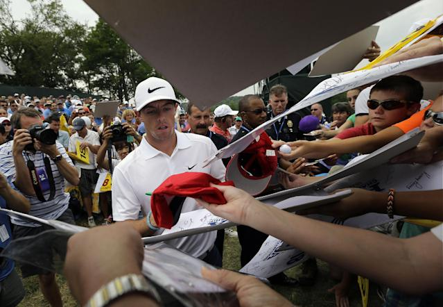 Rory McIlroy, of Northern Ireland, signs autographs after a practice round for the PGA Championship golf tournament at Valhalla Golf Club on Tuesday, Aug. 5, 2014, in Louisville, Ky. The tournament is set to begin on Thursday. (AP Photo/David J. Phillip)