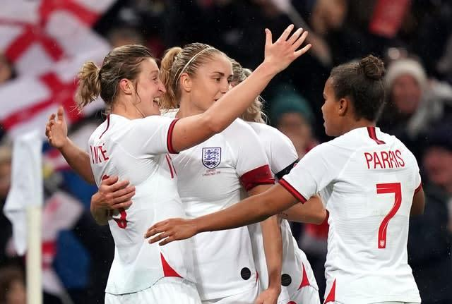 England's Ellen White, left, celebrates (Credit: PA)