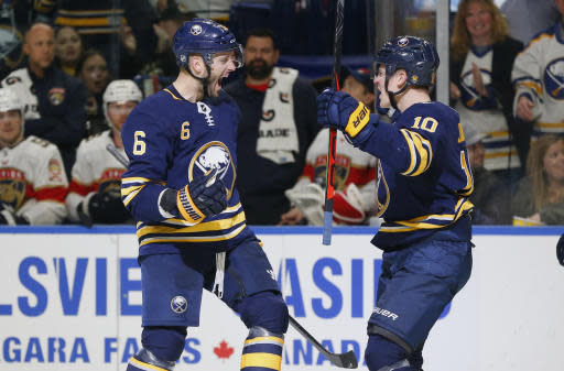 Buffalo Sabres defensemen Marco Scandella (6) and Henri Jokiharju (10) celebrate a goal during the third period of an NHL hockey game, Friday against the Florida Panthers, Oct. 11, 2019, in Buffalo, N.Y. (AP Photo/Jeffrey T. Barnes)