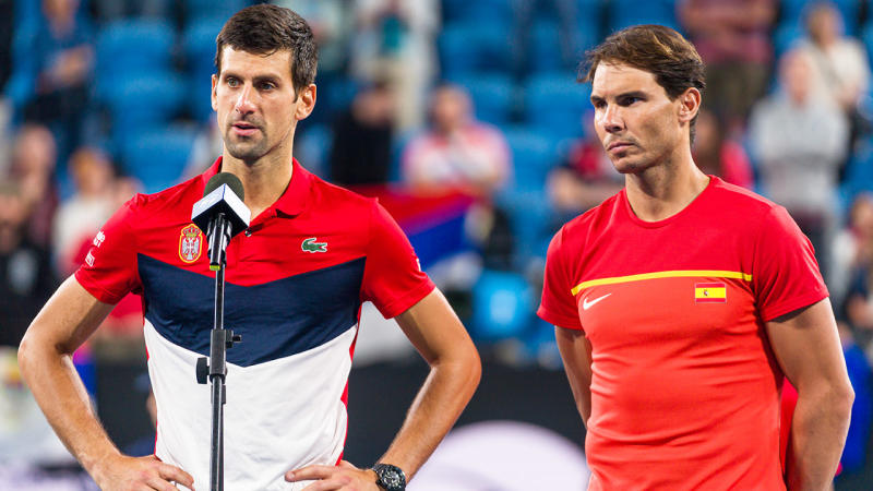 Novak Djokovic (pictured left) with his hands on his hips and Rafael Nadal (pictured right) look forward.