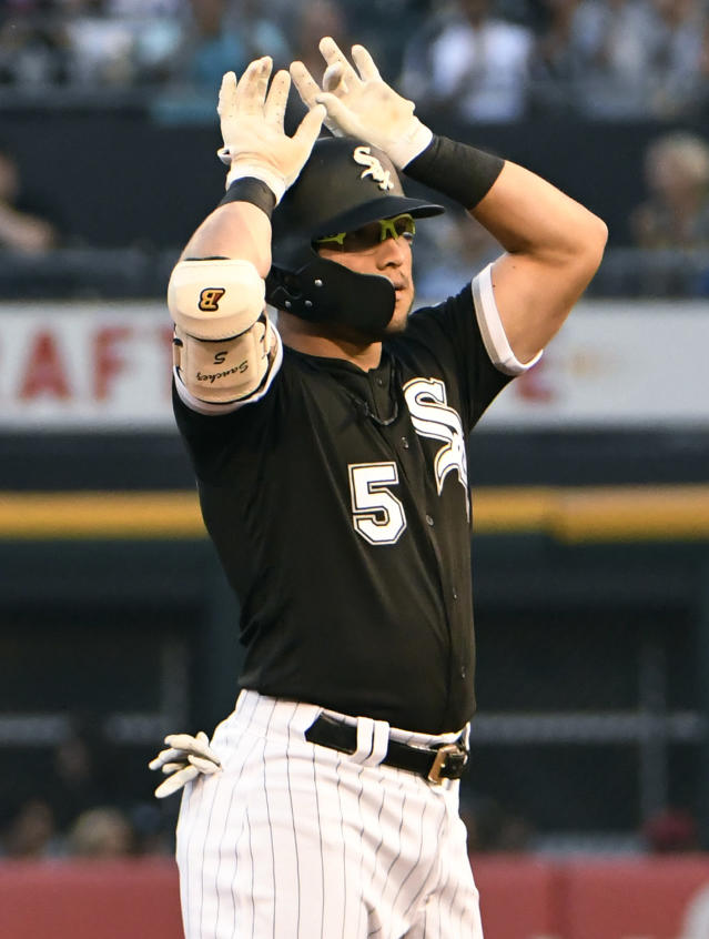 Chicago White Sox's Yolmer Sanchez gestures after hitting a double against the Kansas City Royals during the first inning of a baseball game Wednesday, Aug. 1, 2018, in Chicago. (AP Photo/David Banks)