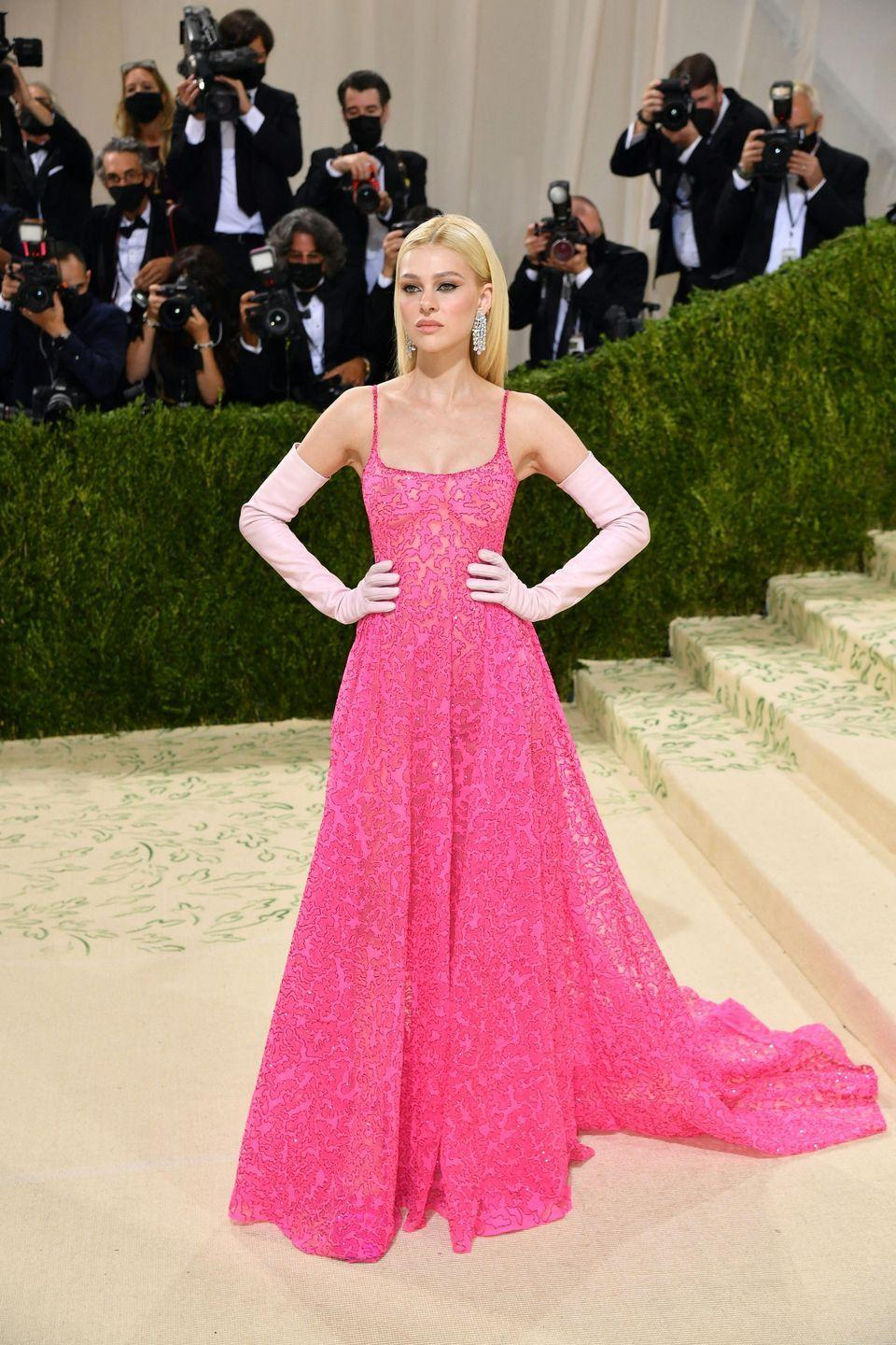 <p>Nicola Peltz wore a pink Valentino Couture gown.</p>