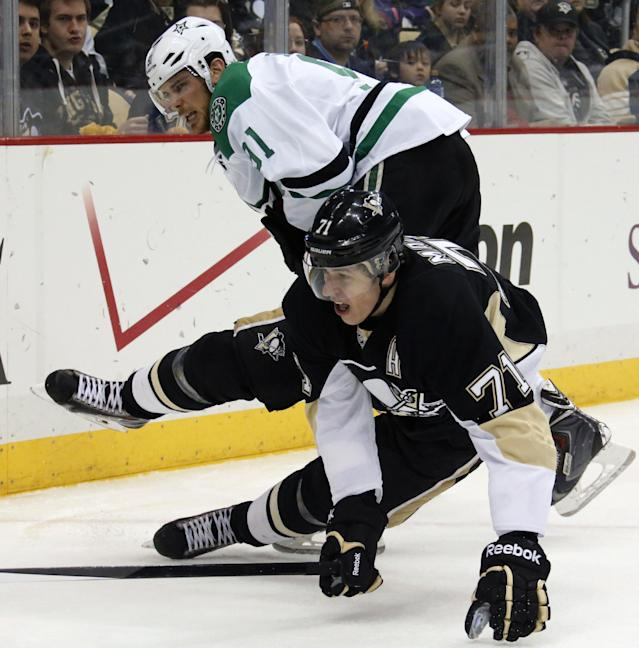 Pittsburgh Penguins' Evgeni Malkin (71) collides with Dallas Stars' Tyler Seguin (91) during the second period of an NHL hockey game in Pittsburgh, Tuesday, March 18, 2014. (AP Photo/Gene Puskar)