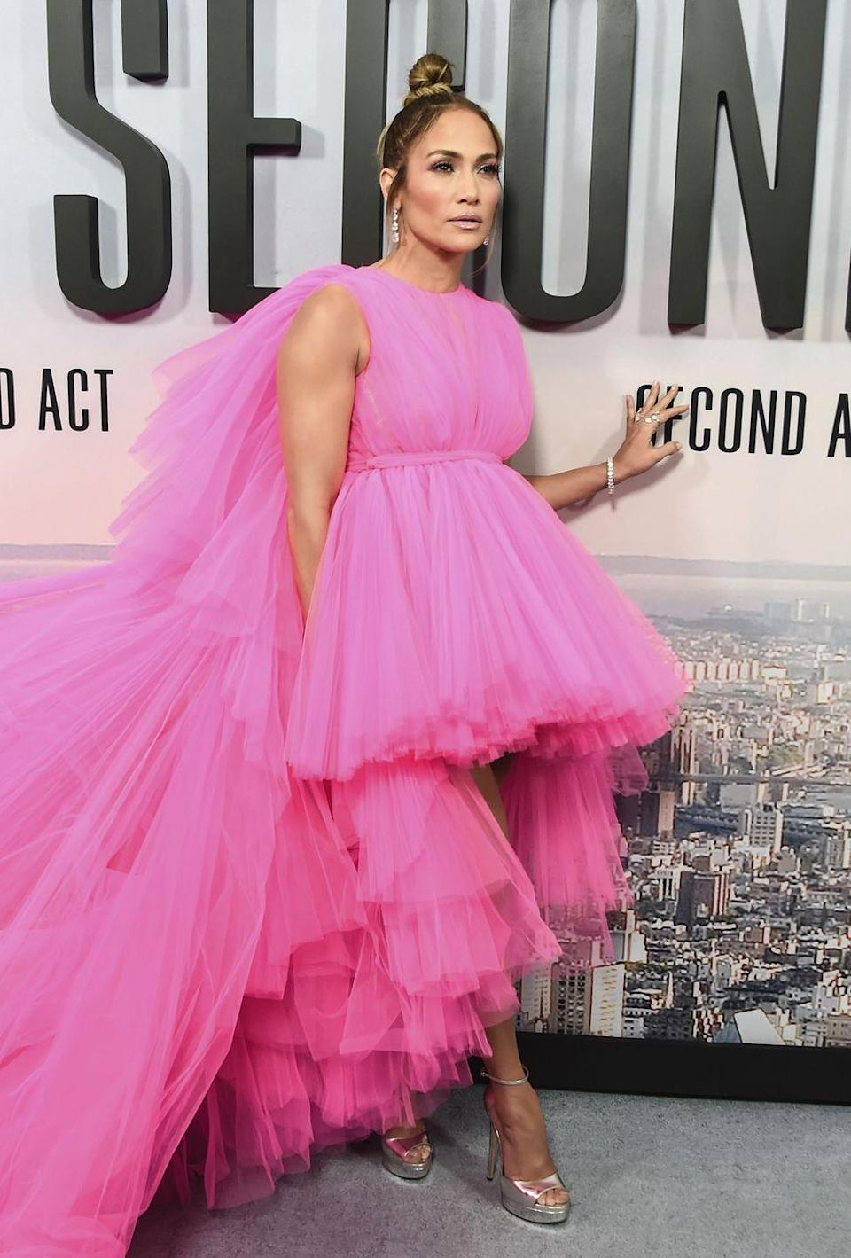 <p>Jennifer Lopez attends the <em>Second Act</em> world premiere in New York City wearing a hot-pink tulle gown by Giambattista Valli. On a related note, I'm now craving cotton candy. </p>