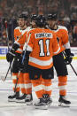 Philadelphia Flyers' Shayne Gostisbehere, right, celebrates his goal with Travis Konecny (11) and Claude Giroux (28) during the second period of an NHL hockey game against the Washington Capitals, Sunday, March 18, 2018, in Philadelphia. (AP Photo/Derik Hamilton)