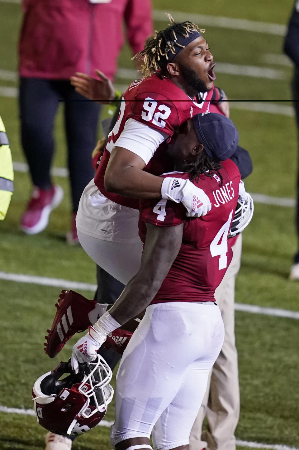 Indiana's Alfred Bryant (92) and Cam Jones celebrate after Indiana defeated Penn State in overtime of an NCAA college football game, Saturday, Oct. 24, 2020, in Bloomington, Ind. Indiana won 36-35 in overtime. (AP Photo/Darron Cummings)