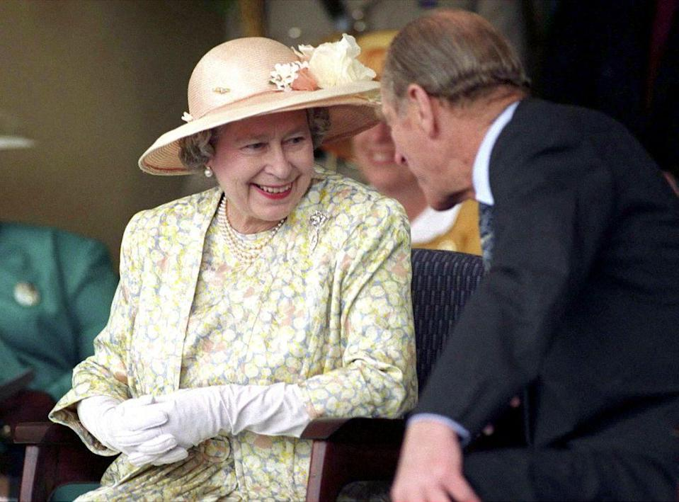 <p>She always looks so happy around him. The Queen & Prince Philip visit Vukuzakhe High School In Durban South Africa in 1995.</p>
