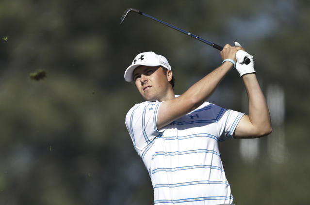 Jordan Spieth sends a divot flying with his second shot on the second hole of the South Course at Torrey Pines during the first round of the Farmers Insurance Open golf tournament Thursday, Jan. 23, 2014, in San Diego. (AP Photo/Lenny Ignelzi)