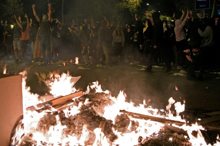 Protesters set fire to barricades during a protest in Barcelona on October 16