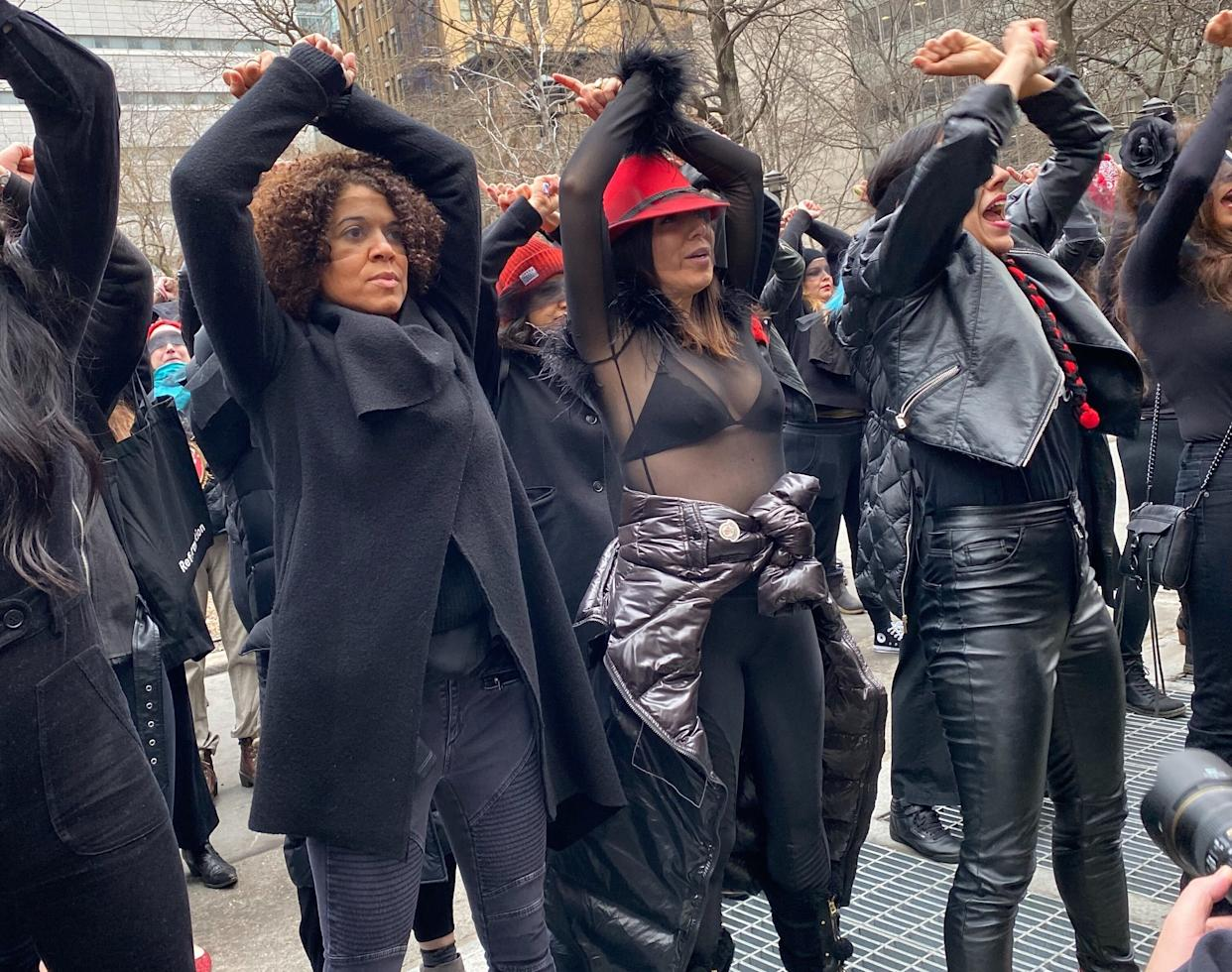 """A group of women activists perform the Chilean anti-rape anthem """"A Rapist In Our Midst"""" outside of the courthouse where Harvey Weinstein's trial is ongoing."""