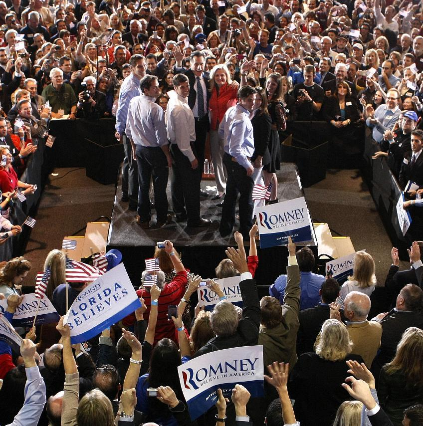 Republican presidential candidate, former Massachusetts Gov. Mitt Romney, waves to supporters with his wife Ann and family at his Florida primary primary night rally in Tampa, Fla., Tuesday, Jan. 31, 2012. (AP Photo/Gerald Herbert)