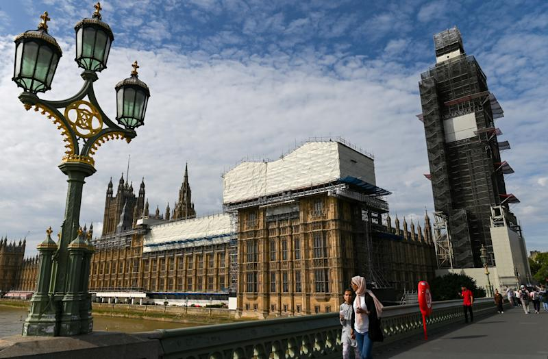 Pedestrians walk past the Palace of Westminster, housing the Houses of Parliament, pictured from Westminster Bridge, in central London on August 28, 2019. - British Prime Minister Boris Johnson announced Wednesday that the suspension of parliament would be extended until October 14 -- just two weeks before the UK is set to leave the EU -- enraging anti-Brexit MPs. (Photo by DANIEL LEAL-OLIVAS / AFP) (Photo credit should read DANIEL LEAL-OLIVAS/AFP/Getty Images)