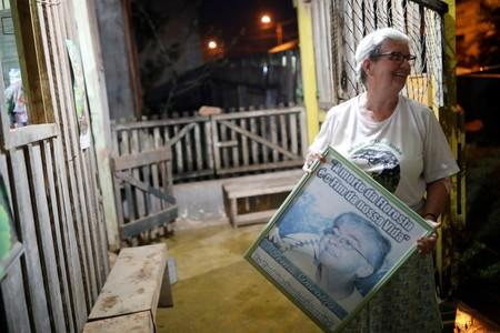 Sister Jane Dwyer holds a picture of Dorothy Stang after an interview with Reuters in Anapu