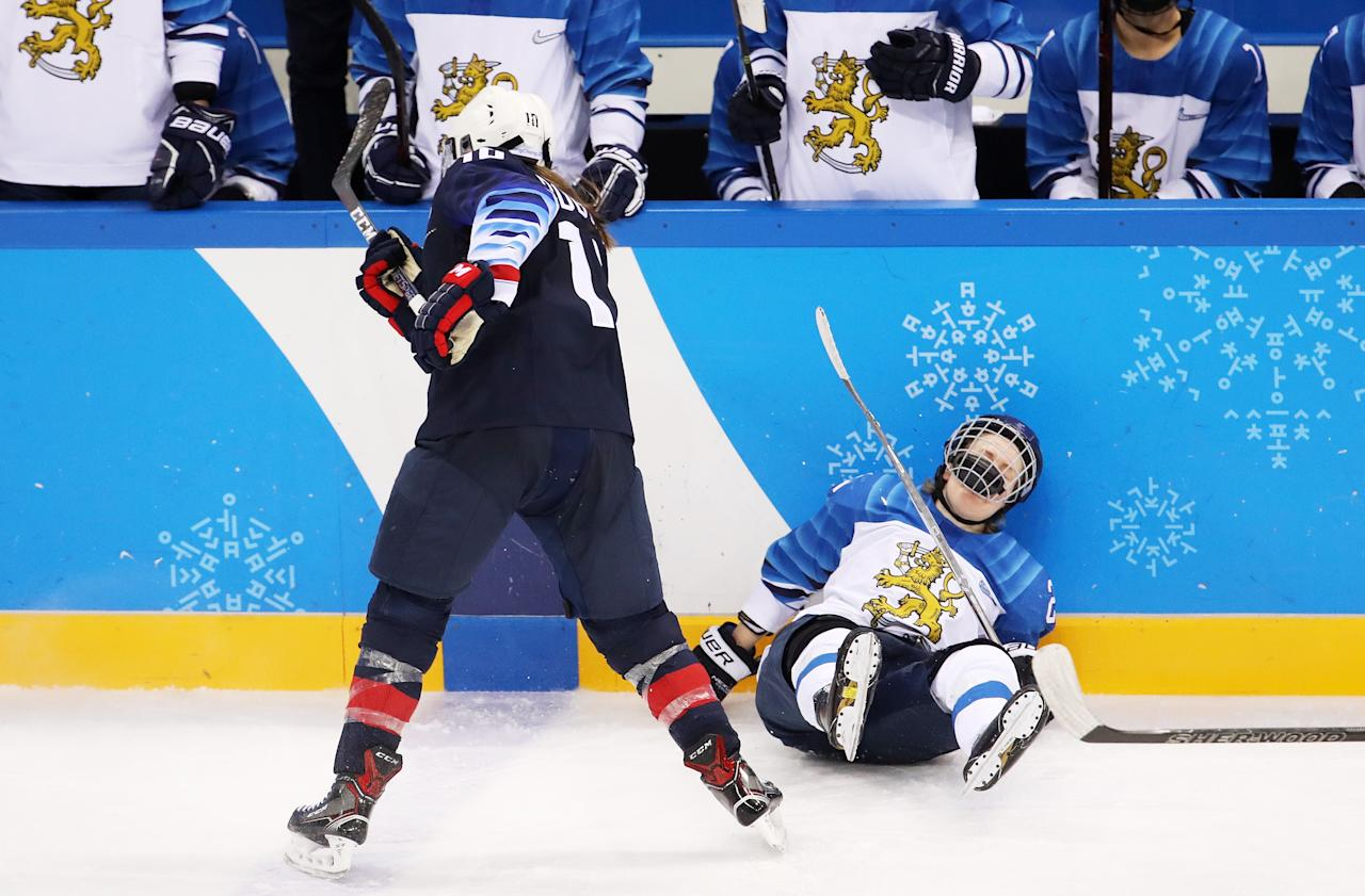 <p>Meghan Duggan #10 of the United States checks Noora Tulus #24 of Finland into the boards during the Ice Hockey Women Play-offs Semifinals on day 10 of the PyeongChang 2018 Winter Olympic Games at Gangneung Hockey Centre on February 19, 2018 in Pyeongchang-gun, South Korea. (Photo by Bruce Bennett/Getty Images) </p>