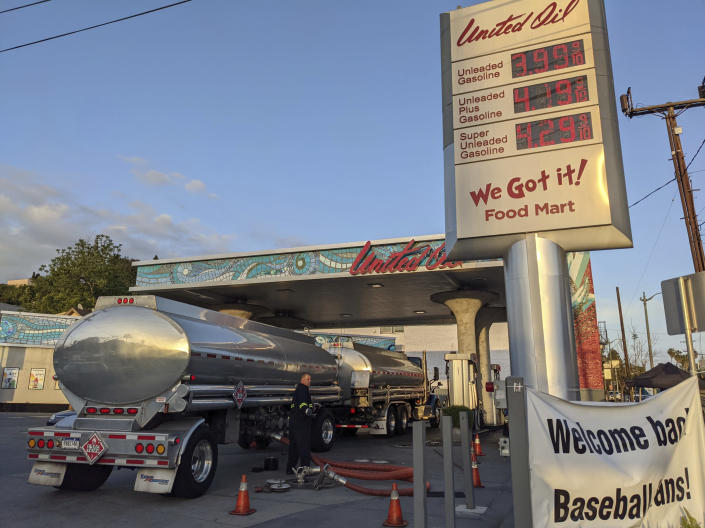 In this Friday, May 20, 2021, photo, a fuel truck driver checks the gasoline tank level at a United Oil gas station in Sunset Blvd., in Los Angeles. The average U.S. price of regular-grade gasoline jumped 8 cents over the past two weeks, to $3.10 per gallon. Industry analyst Trilby Lundberg of the Lundberg Survey said Sunday, May 23, that the increase is attributed to supply disruption from the 10-day shutdown of the Colonial Pipeline following a cyberattack, and a rise in prices for corn, a key ingredient in corn-based ethanol that must be blended by refiners into gasoline. (AP Photo/Damian Dovarganes)