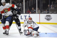Florida Panthers goaltender Sergei Bobrovsky, right, is scored on by Los Angeles Kings center Trevor Moore, center, as defenseman Josh Brown defends during the second period of an NHL hockey game Thursday, Feb. 20, 2020, in Los Angeles. (AP Photo/Mark J. Terrill)