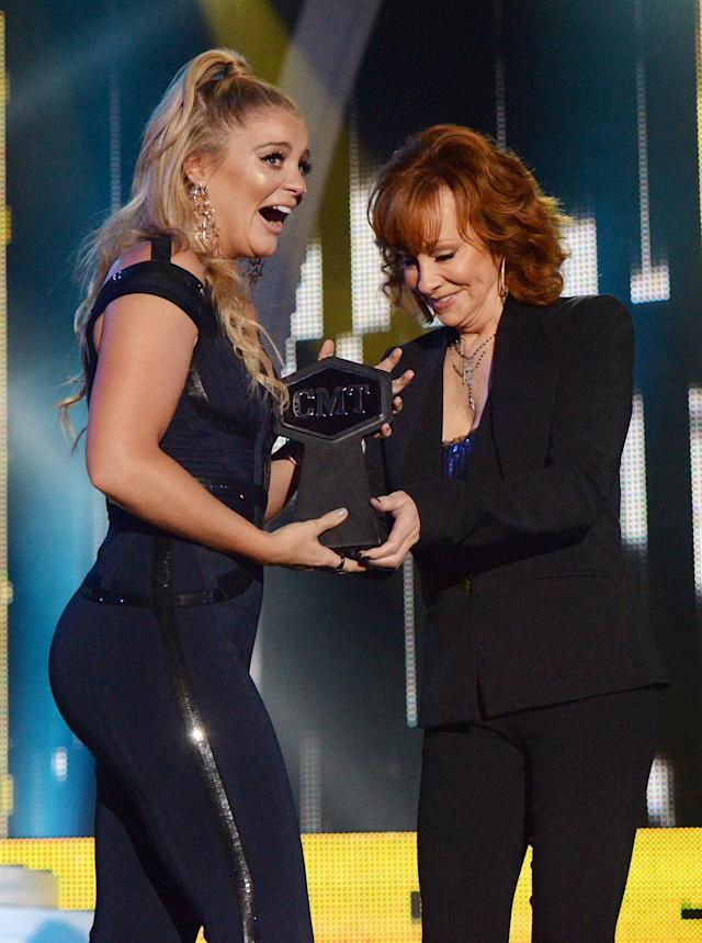 <p>Lauren Alaina accepts an award onstage from Reba McEntire at the 2017 CMT Music Awards at the Music City Center on June 7, 2017 in Nashville, Tennessee. (Photo by Kevin Mazur/WireImage) </p>