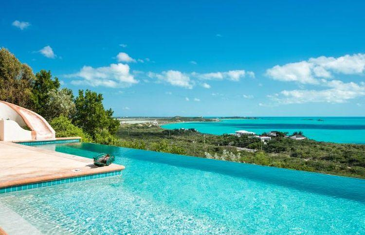 "Only a 10-minute drive to the world-renowned Grace Bay Beach, this luxury villa is nestled along the Turtle Tail area of the island, giving guests complete privacy. The custom-designed home includes a lap and infinity pool with a jaw-dropping 270-degree view of the uninhabited islands of the Caribbean. It even includes a hammock and water slide. <a href=""https://www.flipkey.com/properties/6637509/"" target=""_blank"">Check it out</a>."