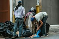 An economic crisis marked by severe shortages has left some Venezuelans scavenging for food, as seen here in Caracas on February 22, 2017