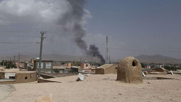 Clashes continue as Taliban press Afghan city south of Kabul