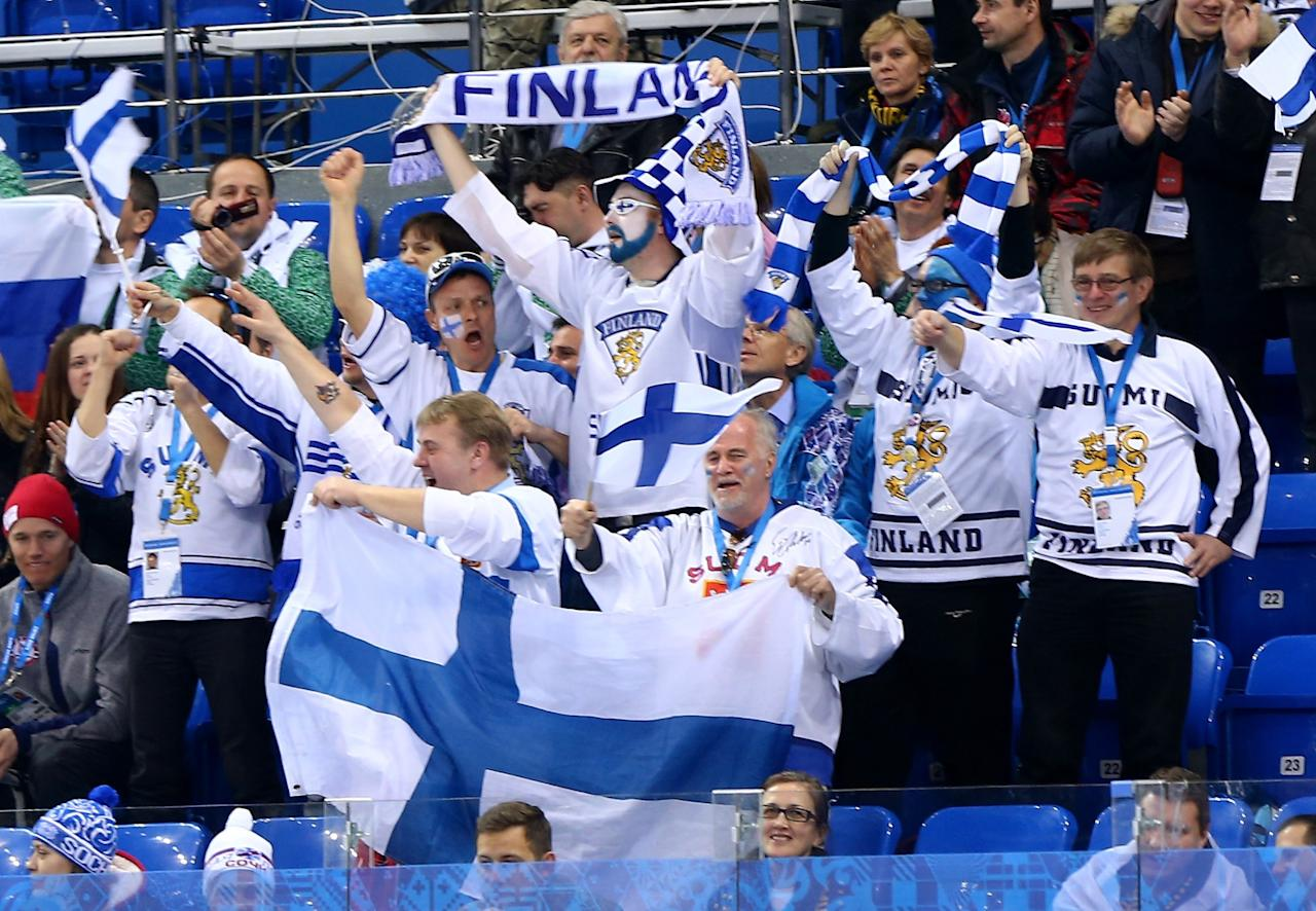 SOCHI, RUSSIA - FEBRUARY 14: Finland fans celebrate in the first period against Norway during the Men's Ice Hockey Preliminary Round Group B game on day seven of the Sochi 2014 Winter Olympics at Shayba Arena on February 14, 2014 in Sochi, Russia. (Photo by Martin Rose/Getty Images)