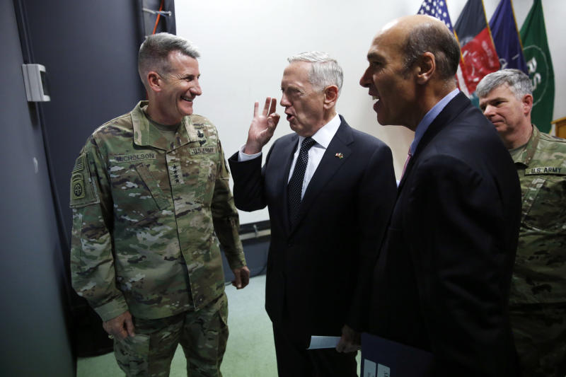 U.S. Defense Secretary James Mattis, center, chats with U.S. Army General John Nicholson, left, commander of U.S. Forces Afghanistan, after a news conference at Resolute Support headquarters in Kabul, Afghanistan, Monday, April 24, 2017. Mattis arrived unannounced in Afghanistan to assess America's longest war as the Trump administration weighs sending more U.S. troops. (Jonathan Ernst/Pool Photo via AP)
