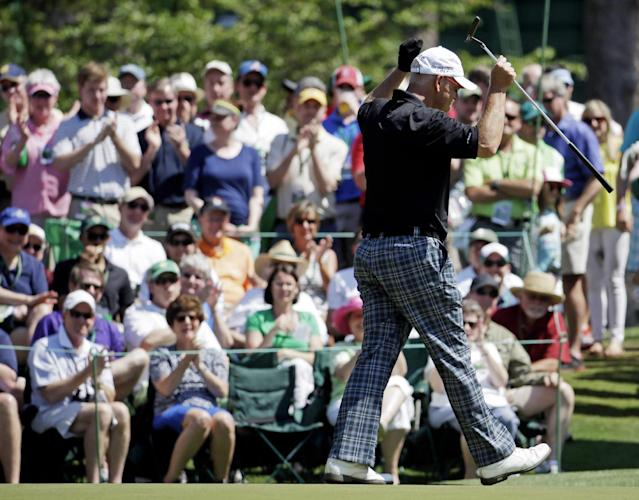 Sandy Lyle, of Scotland, celebrates after a birdie on the sixth green during the third round of the Masters golf tournament Saturday, April 12, 2014, in Augusta, Ga. (AP Photo/Darron Cummings)