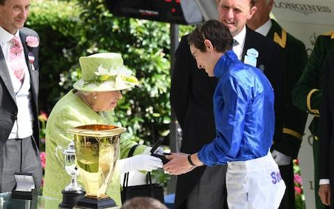 <span>The Queen congratulates jockey James Doyle after the Diamond Jubilee Stakes </span> <span>Credit: REX </span>