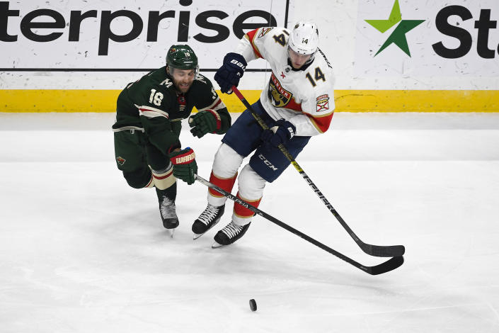 Minnesota Wild winger Jason Zucker (16) and Florida Panthers center Dominic Toninato battle for control of the puck during the first period of an NHL hockey game Monday, Jan. 20, 2020, in St. Paul, Minn. (AP Photo/Craig Lassig)
