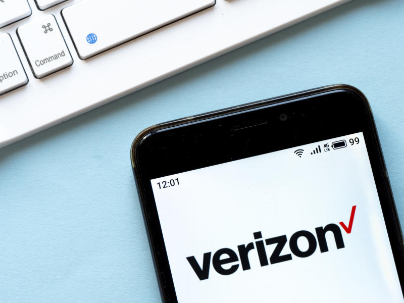 In this photo illustration a Verizon logo seen displayed on...