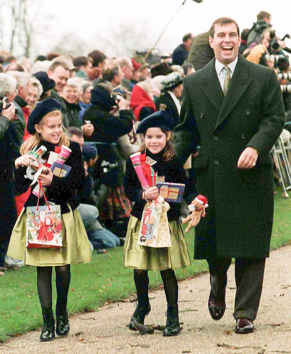 <p>Princesses Beatrice and Eugenie (with dad Prince Andrew) showed an early fondness for major hats.</p>