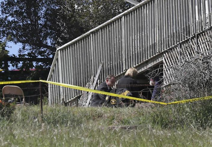 San Luis Obispo Sheriff's Office personnel dig under the deck of the home of Ruben Flores, March 16, 2021, in Arroyo Grande.