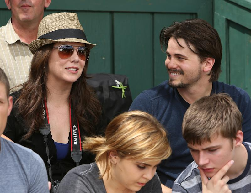 "This image released by NBC shows Lauren Graham, left, and Jason Ritter in a scene from ""Parenthood.""  Ritter says working with Lauren Graham on NBC's ""Parenthood"" is ""one of the greatest experiences"" of his life. Ritter was introduced in the first season of ""Parenthood"" for a three-episode arc. It was written that he would date Sarah but they would soon break up, but the show's producers and writers were so impressed with Ritter's performance, they kept writing him into episodes. (AP Photo/NBC, Danny Feld)"