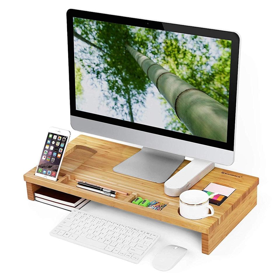 <p>This <span>Songmics Bamboo Wood Monitor Stand </span> ($32) even has a place to put your coffee mug.</p>