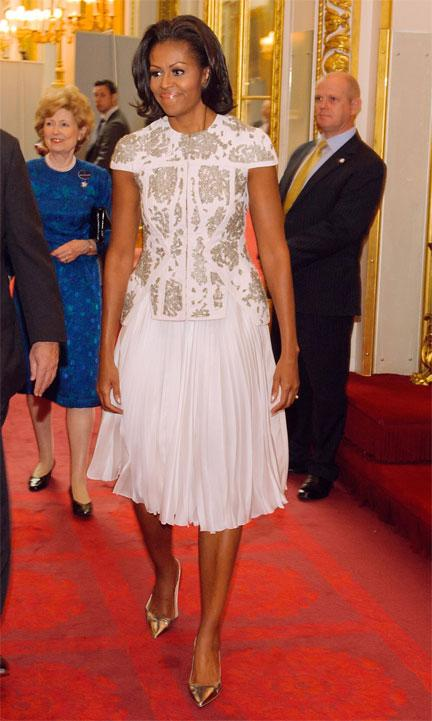 US First Lady Michelle Obama and US Ambassador Louis Susman attend a reception at Buckingham Palace for Heads of State and Government attending the Olympics Opening Ceremony on July 27, 2012 in London, England. (Photo by Dominic Lipinski - WPA Pool/Getty Images)