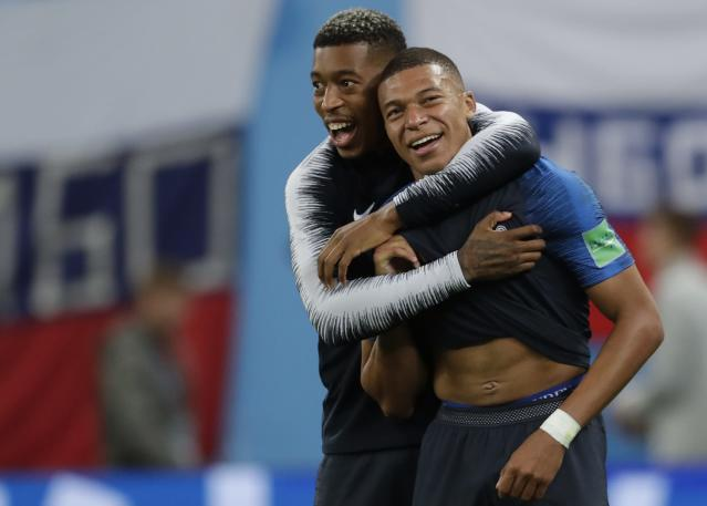 France's Kylian Mbappe, right, and Presnel Kimpembe celebrate at the end of the semifinal match between against Belgium. (AP Photo/Petr David Josek)