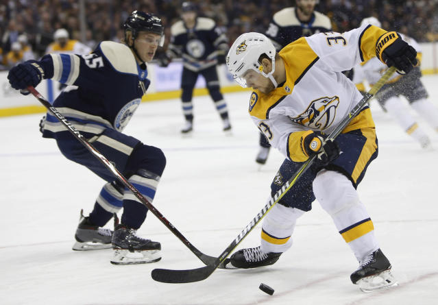 Nashville Predators' Viktor Arvidsson, right, of Sweden, steals the puck from Columbus Blue Jackets' Markus Nutivaara, of Finland, during the first period of an NHL hockey game Thursday, Jan. 10, 2019, in Columbus, Ohio. (AP Photo/Jay LaPrete)