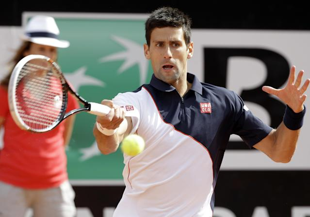 Serbia's Novak Djokovic returns the ball to Spain's Rafael Nadal during their final match at the Italian Open tennis tournament, in Rome, Sunday, May 18, 2014. (AP Photo/Andrew Medichini)