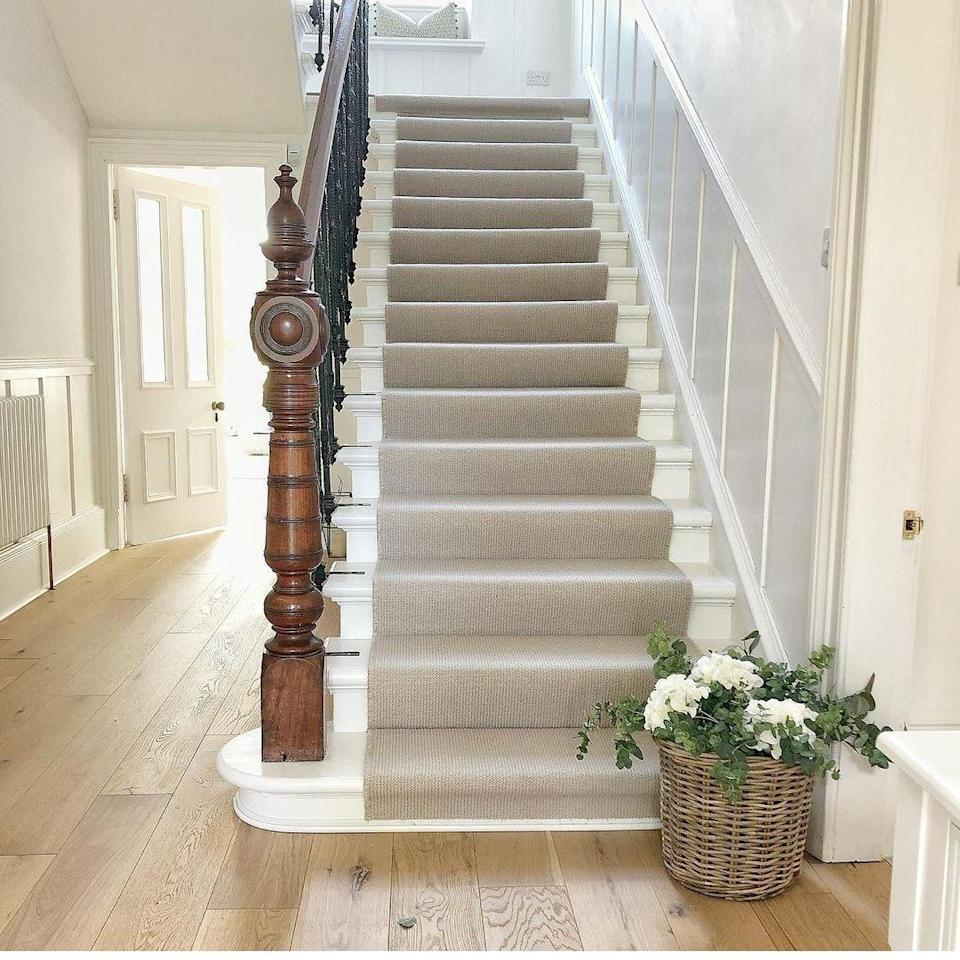 """<p>Refresh your <a href=""""https://www.housebeautiful.com/uk/decorate/hallway/a2283/hallway-decorating-ideas-tips/"""" rel=""""nofollow noopener"""" target=""""_blank"""" data-ylk=""""slk:entryway"""" class=""""link rapid-noclick-resp"""">entryway</a> with a calming colour palette. Classic and elegant, it's the ultimate way to create a welcoming first impression. And, it looks brilliant with <a href=""""https://www.housebeautiful.com/uk/renovate/diy/a35288060/how-to-panel-wall/"""" rel=""""nofollow noopener"""" target=""""_blank"""" data-ylk=""""slk:hallway panelling"""" class=""""link rapid-noclick-resp"""">hallway panelling</a>.</p><p>'Neutral shades can lighten up a small or dark entrance by accentuating the feeling of space, while gentle stripes add a stylish feature to your staircase,' adds Jess.</p><p>Pictured: <a href=""""https://www.cormarcarpets.co.uk/carpet-ranges/wool-loop/avebury/"""" rel=""""nofollow noopener"""" target=""""_blank"""" data-ylk=""""slk:'Avebury' by Cormar Carpets"""" class=""""link rapid-noclick-resp"""">'Avebury' by Cormar Carpets</a><strong><br><br>Follow House Beautiful on <a href=""""https://www.instagram.com/housebeautifuluk/"""" rel=""""nofollow noopener"""" target=""""_blank"""" data-ylk=""""slk:Instagram"""" class=""""link rapid-noclick-resp"""">Instagram</a>.</strong></p><p><strong>Like this article? <a href=""""https://hearst.emsecure.net/optiext/cr.aspx?ID=DR9UY9ko5HvLAHeexA2ngSL3t49WvQXSjQZAAXe9gg0Rhtz8pxOWix3TXd_WRbE3fnbQEBkC%2BEWZDx"""" rel=""""nofollow noopener"""" target=""""_blank"""" data-ylk=""""slk:Sign up to our newsletter"""" class=""""link rapid-noclick-resp"""">Sign up to our newsletter</a> to get more articles like this delivered straight to your inbox.</strong></p><p><a class=""""link rapid-noclick-resp"""" href=""""https://hearst.emsecure.net/optiext/cr.aspx?ID=DR9UY9ko5HvLAHeexA2ngSL3t49WvQXSjQZAAXe9gg0Rhtz8pxOWix3TXd_WRbE3fnbQEBkC%2BEWZDx"""" rel=""""nofollow noopener"""" target=""""_blank"""" data-ylk=""""slk:SIGN UP"""">SIGN UP</a></p><p>Love what you're reading? Enjoy <a href=""""https://go.redirectingat.com?id=127X1599956&url=https%3A%2F%2Fwww.hearstmagazines.co.uk%2Fhb%2Fhouse-beaut"""