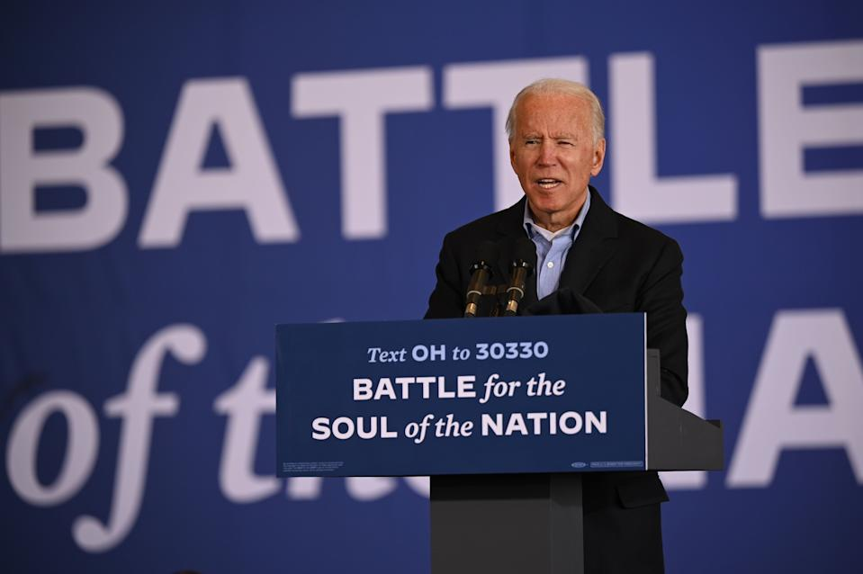 Democratic presidential candidate Joe Biden speaks at a drive-in get out the vote event at Burke Lakefront Airport on November 2, 2020 in Cleveland, Ohio.