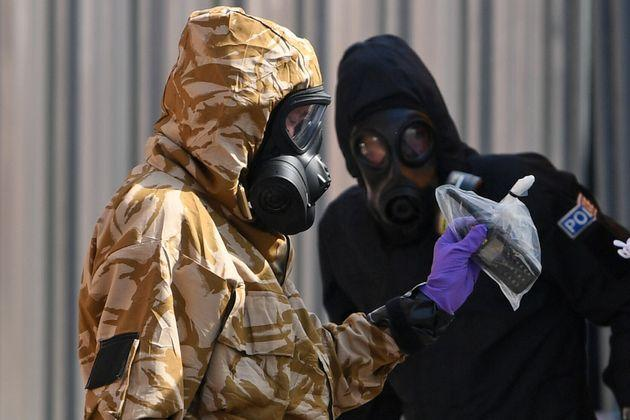 Investigators in protective suits looking into the poisoning in 2018 (Photo: CHRIS J RATCLIFFE via Getty Images)