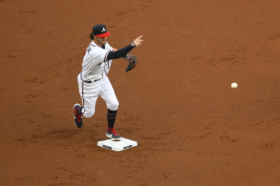 Atlanta Braves shortstop Dansby Swanson throws to first base during the first inning of a baseball game against the Tampa Bay Rays, Wednesday, July 29, 2020 in Atlanta. Yoshi Tsutsugo and Yandy Diaz were out on the double play. (AP Photo/John Amis)