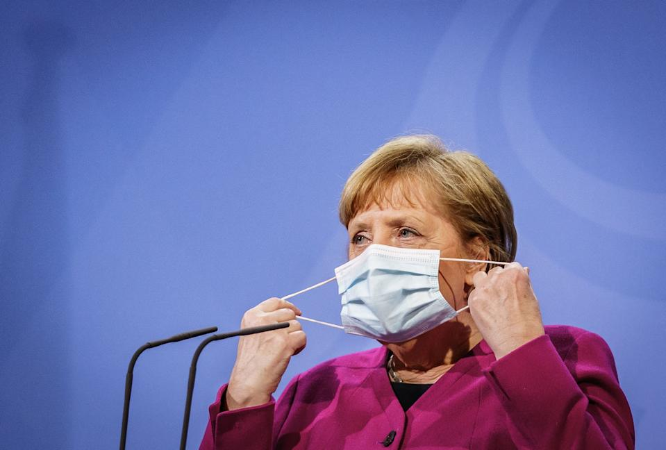 German Chancellor Angela Merkel takes her face protection mask off to give a press statement at the Chancellery in Berlin on March 25, 2021, following a European Union (EU) summit via video conference with EU leaders. (Photo by Michael Kappeler / POOL / AFP) (Photo by MICHAEL KAPPELER/POOL/AFP via Getty Images)