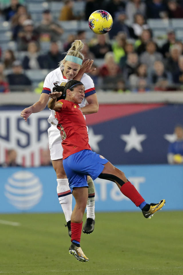 United States midfielder Julie Ertz goes up for a header over Costa Rica midfielder Shirley Curz during the first half of an international friendly soccer match Sunday, Nov. 10, 2019, in Jacksonville, Fla. (AP Photo/John Raoux)