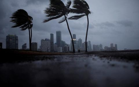 Dark clouds are seen over Miami's skyline before the arrival of Hurricane Irma - Credit: Carlos Barria/Reuters