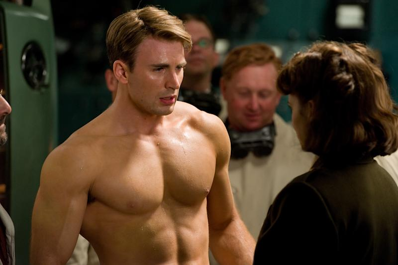 """In this film publicity image released by Paramount Pictures, Hayley Atwell portrays Peggy Carter, right, and Chris Evans portrays Steve Rogers in a scene from the film """"Captain America: The First Avenger.""""  (AP Photo/Paramount Pictures, Jay Maidment)"""