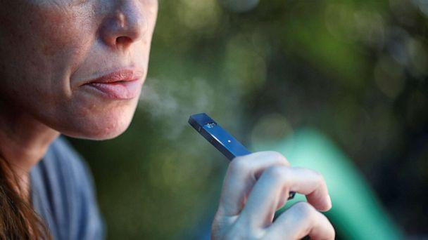 PHOTO: A woman smokes a Juul e-cigarette in this posed picture, Sept. 16, 2018. (Ronen Zvulun/Reuters, FILE)