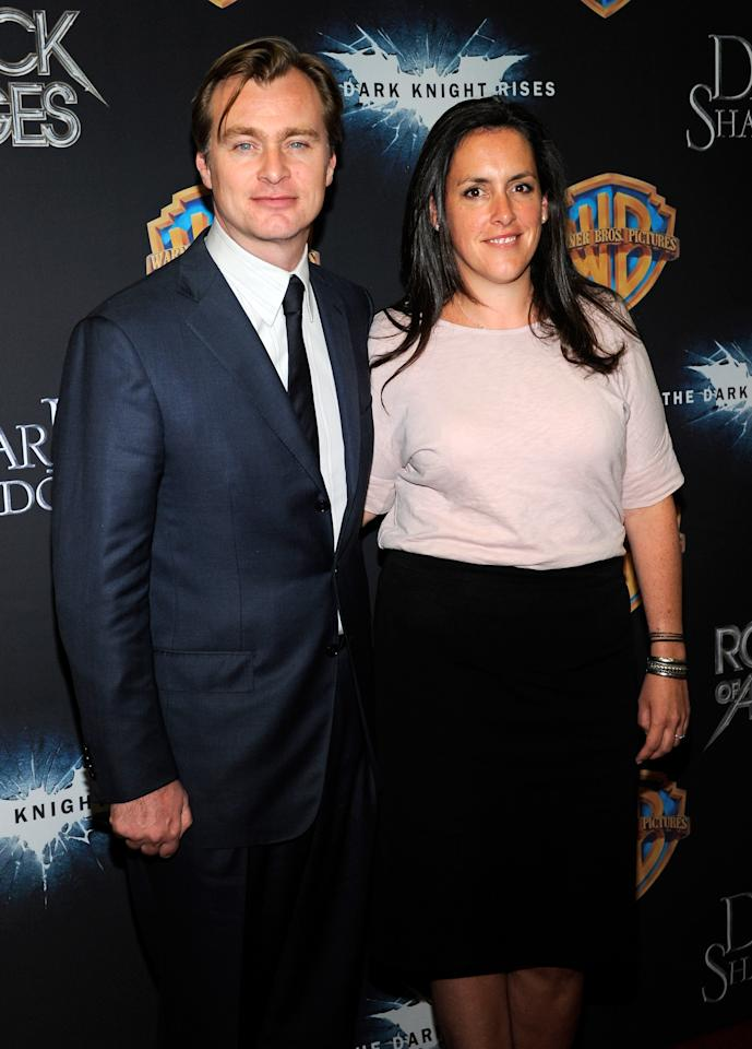 "LAS VEGAS, NV - APRIL 24:  Director Christopher Nolan (L) and his wife, producer Emma Thomas, arrive at a Warner Bros. Pictures presentation to promote their upcoming movie, ""The Dark Knight Rises"" at The Colosseum at Caesars Palace during CinemaCon, the official convention of the National Association of Theatre Owners, April 24, 2012 in Las Vegas, Nevada.  (Photo by Ethan Miller/Getty Images)"