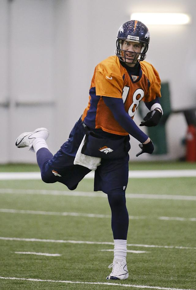 Denver Broncos quarterback Peyton Manning passes during practice Thursday, Jan. 30, 2014, in Florham Park, N.J. The Broncos are scheduled to play the Seattle Seahawks in the NFL Super Bowl XLVIII football game Sunday, Feb. 2, in East Rutherford, N.J. (AP Photo)